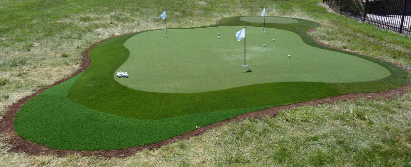 Three shades of putting green turf for backyard green with chipping surround