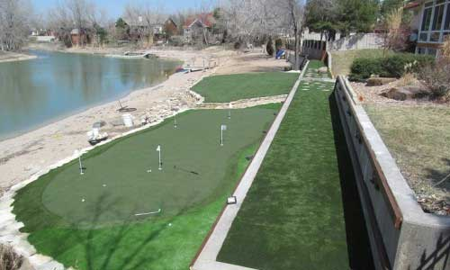 Artififical putting green with five flags that banks Missouri river