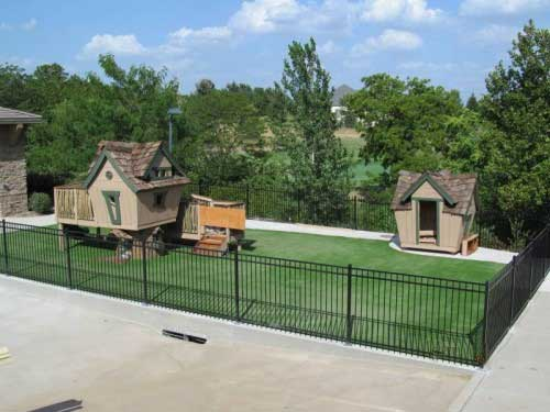 Cartoonish backyard playset on top of lush playground turf in Des Moines, Iowa