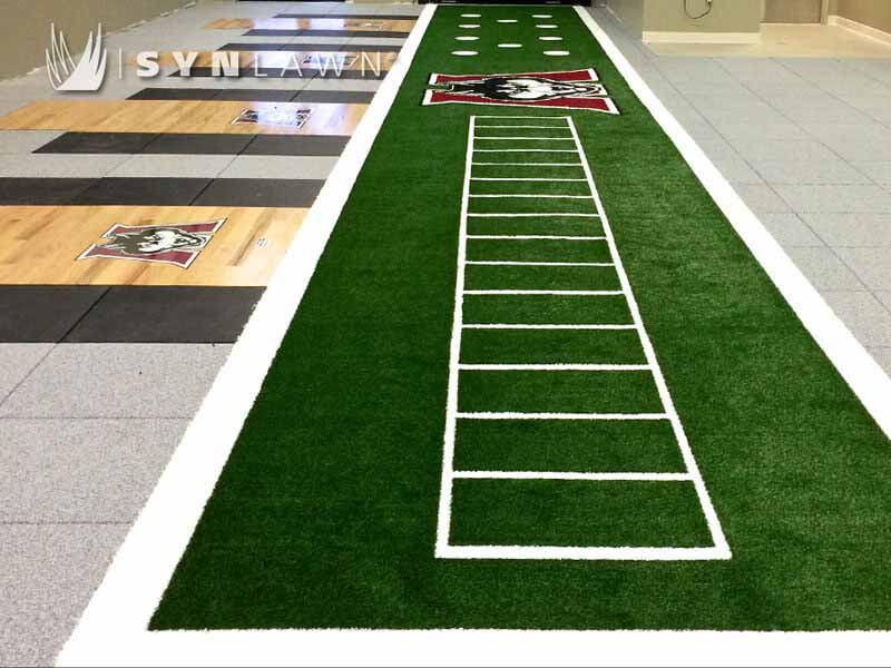 SYNLawn SpeedTurf Track at university indoor facility with logo embedded in the turf