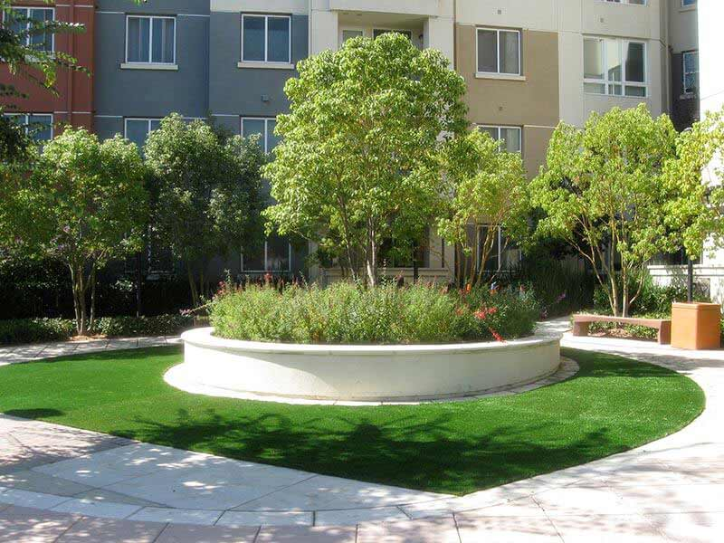 Commercial artificial turf surrounds teardrop shaped courtyard at Kansas apartment complex