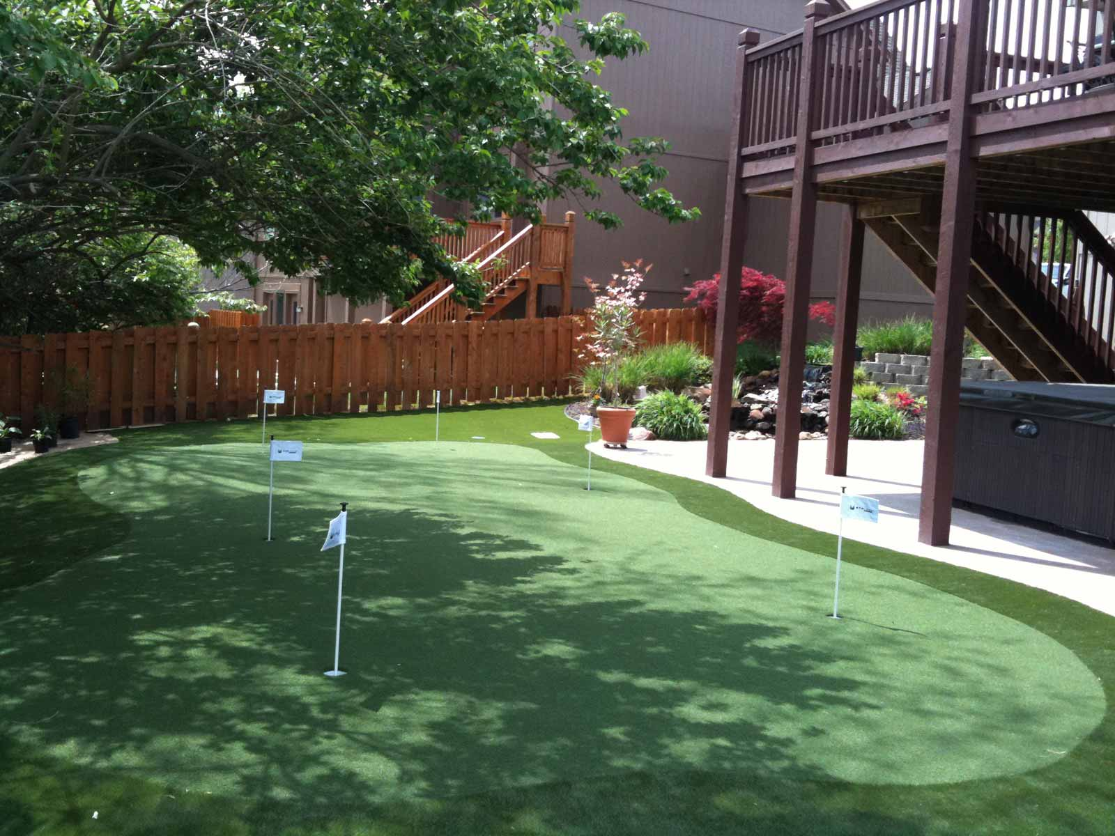 Large backyard putting green with six holes for customer Marty Albertson in Missouri