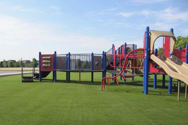 Large playground turf installation at colorful playground in Southern Illinois