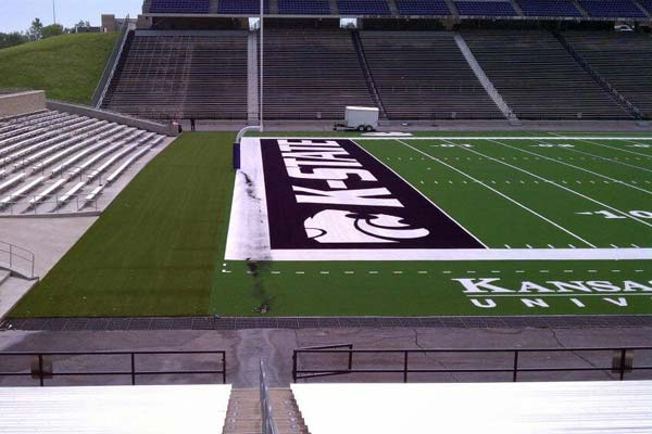 Artificial field turf for Kansas State University football field with KSU logos