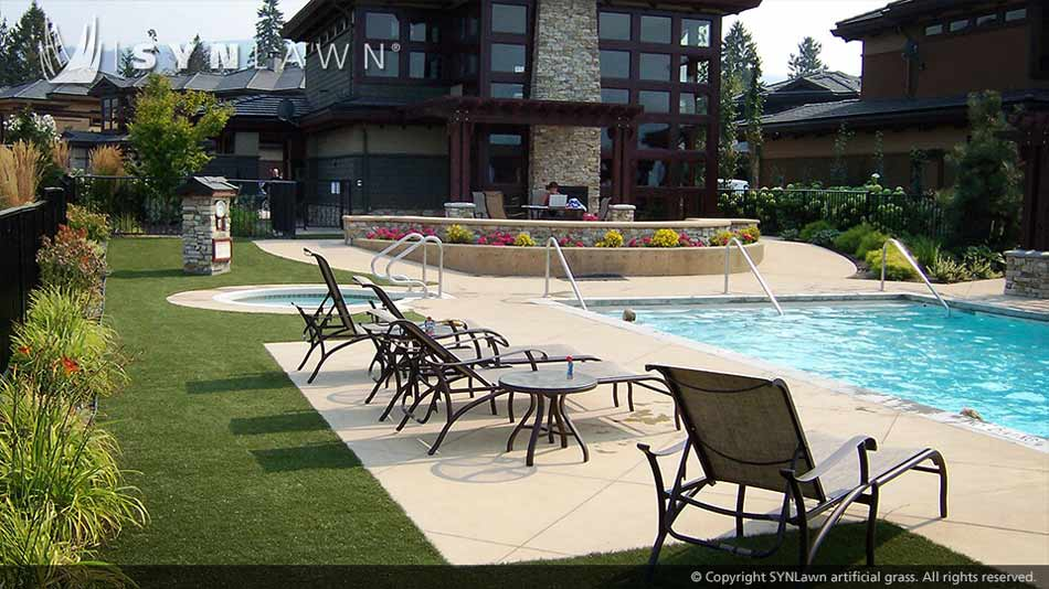 Artificial grass surrounds pool deck area for commercial resort in Kansas