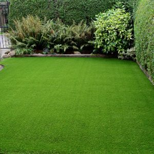 Newly laid artificial lawn in a front garden.
