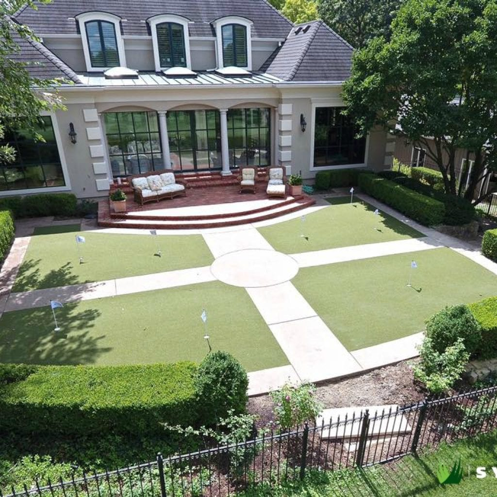 Artificial turf backyard with putting green