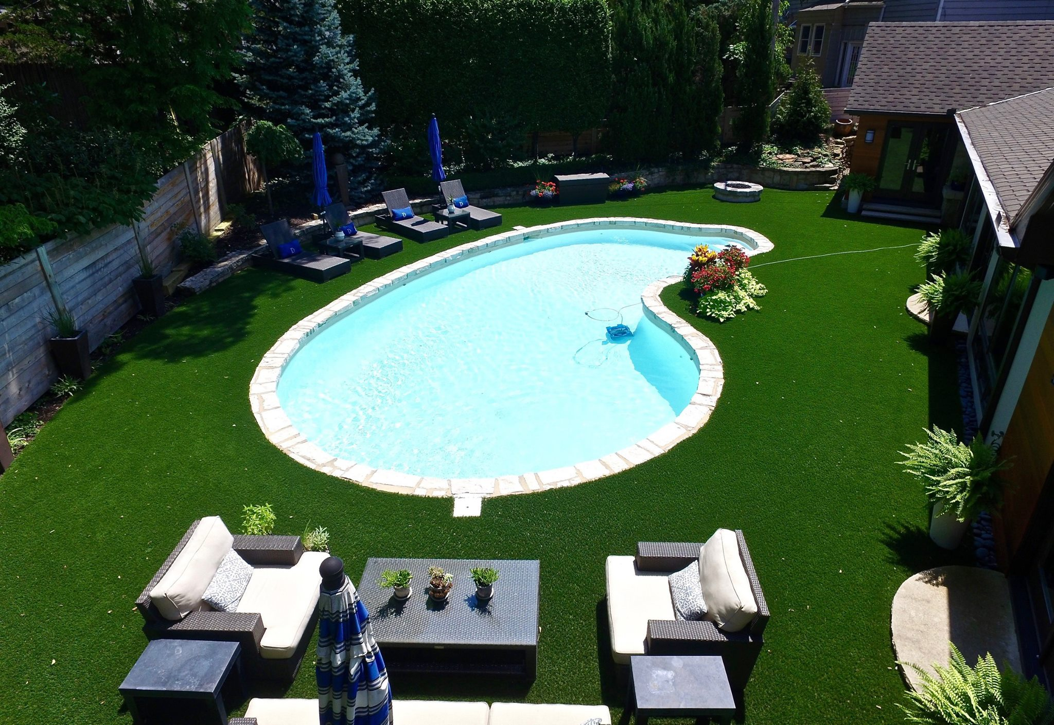 Kansas City backyard with artificial turf and a pool
