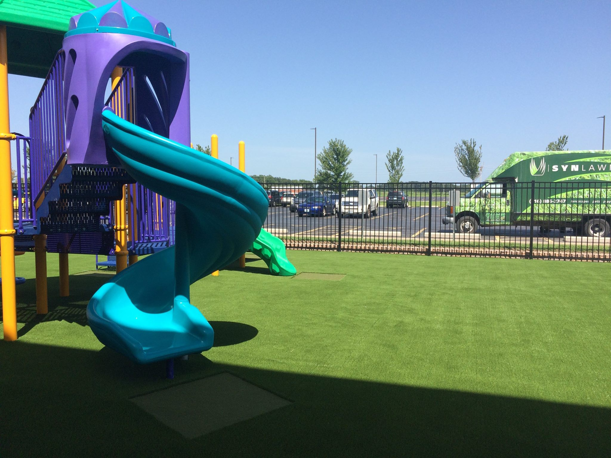 A colorful playground on SYNLawn artificial grass.