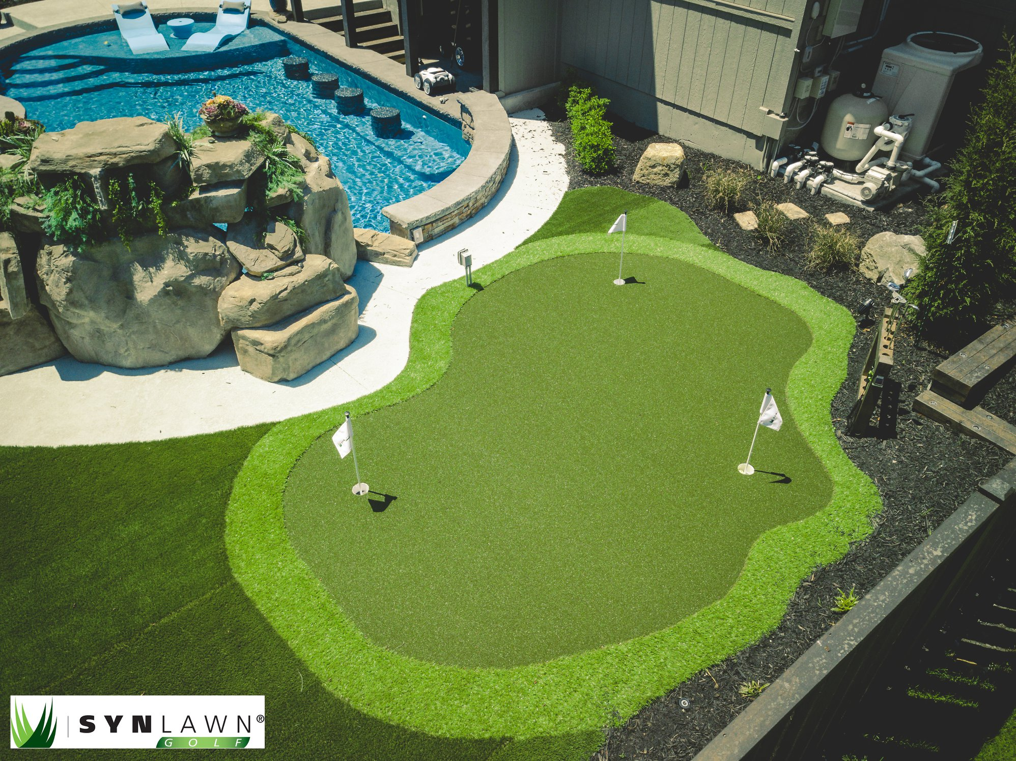 Kansas City backyard with an artificial grass putting green and pool.